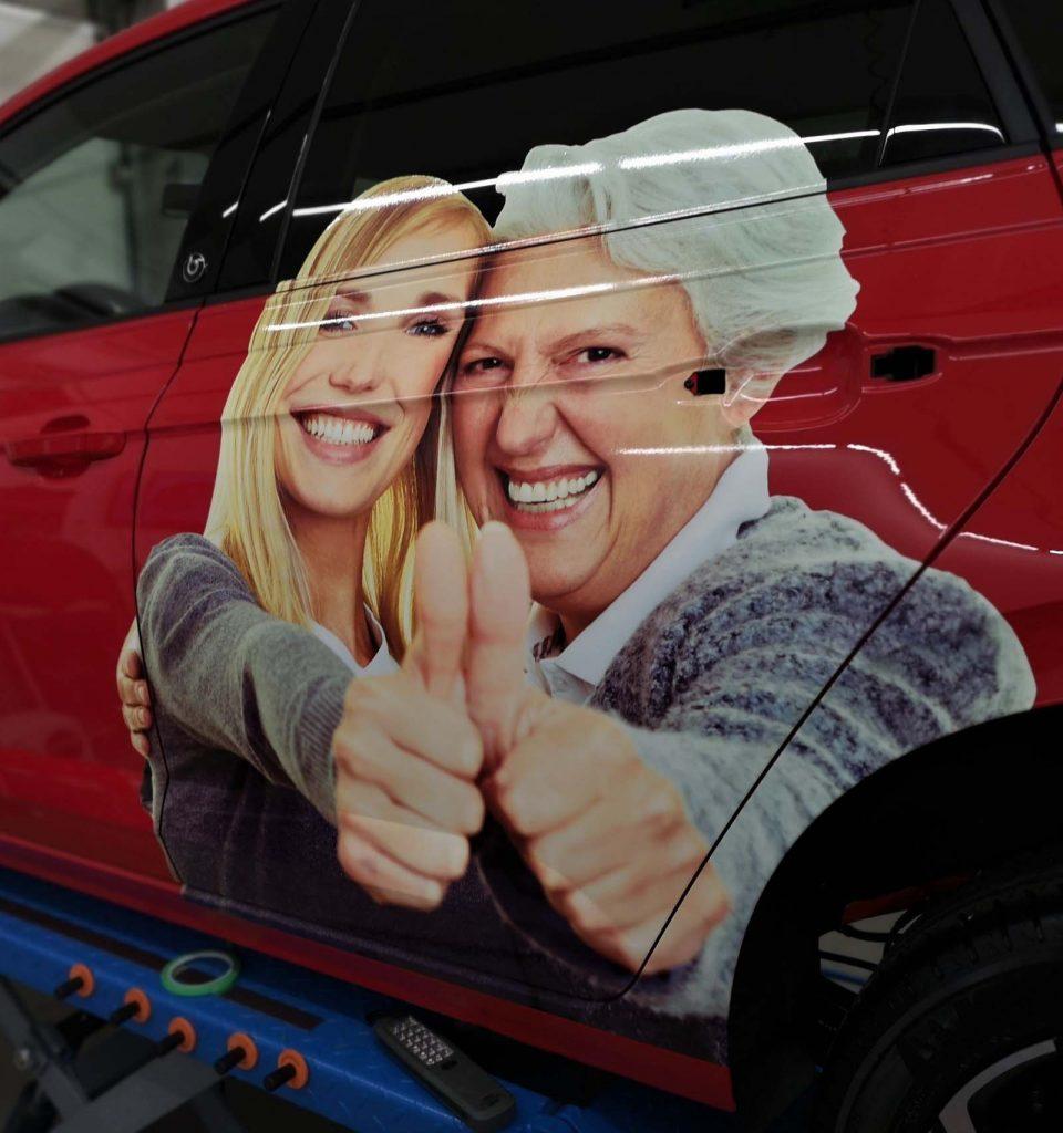 Autobeschriftung, Fahrzeugbeschriftung, Folierungen VW Polo rot